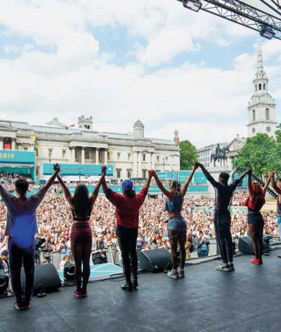 Picture of performers on stage at event in Trafalgar Square.