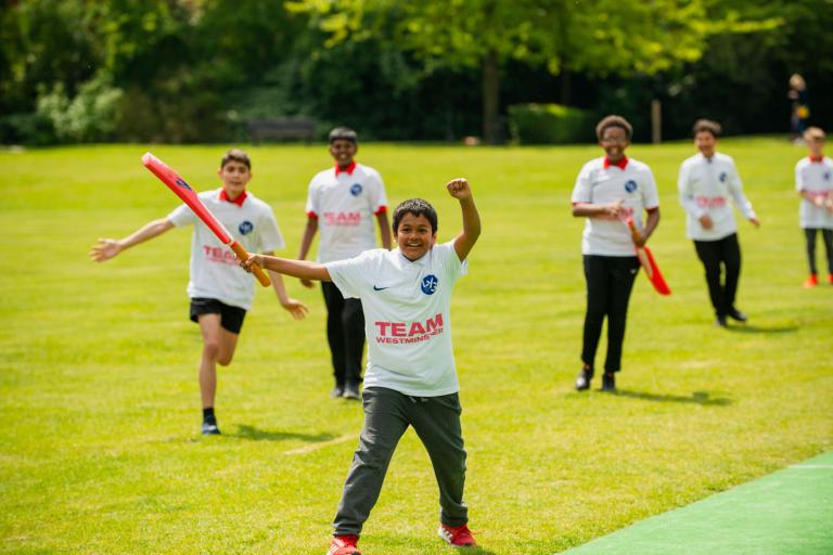 Children from Team Westminster playing cricket at Paddington recreational ground