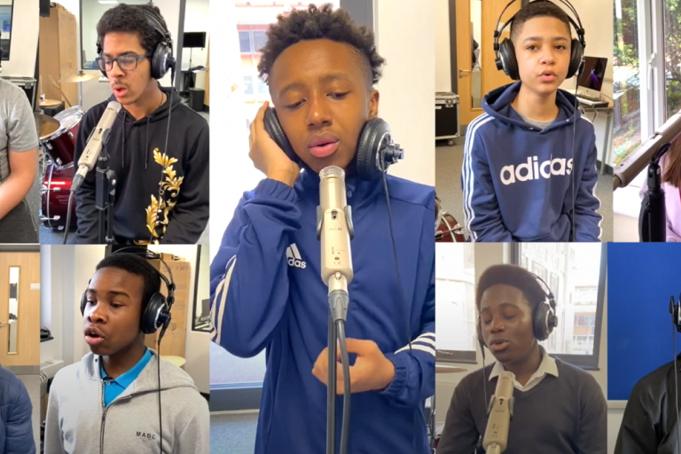 Westminster City School musicians singing together in a music video.png