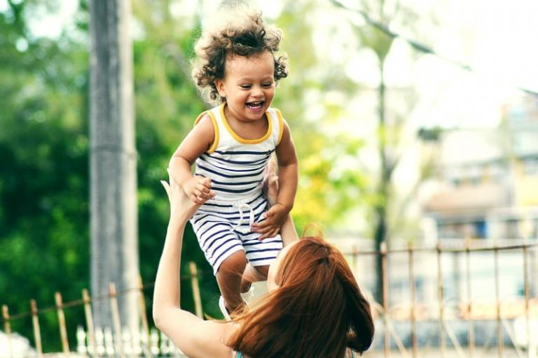 Woman lifting a happy child