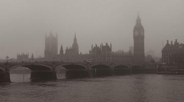 a mist city scape of the palace of westminster